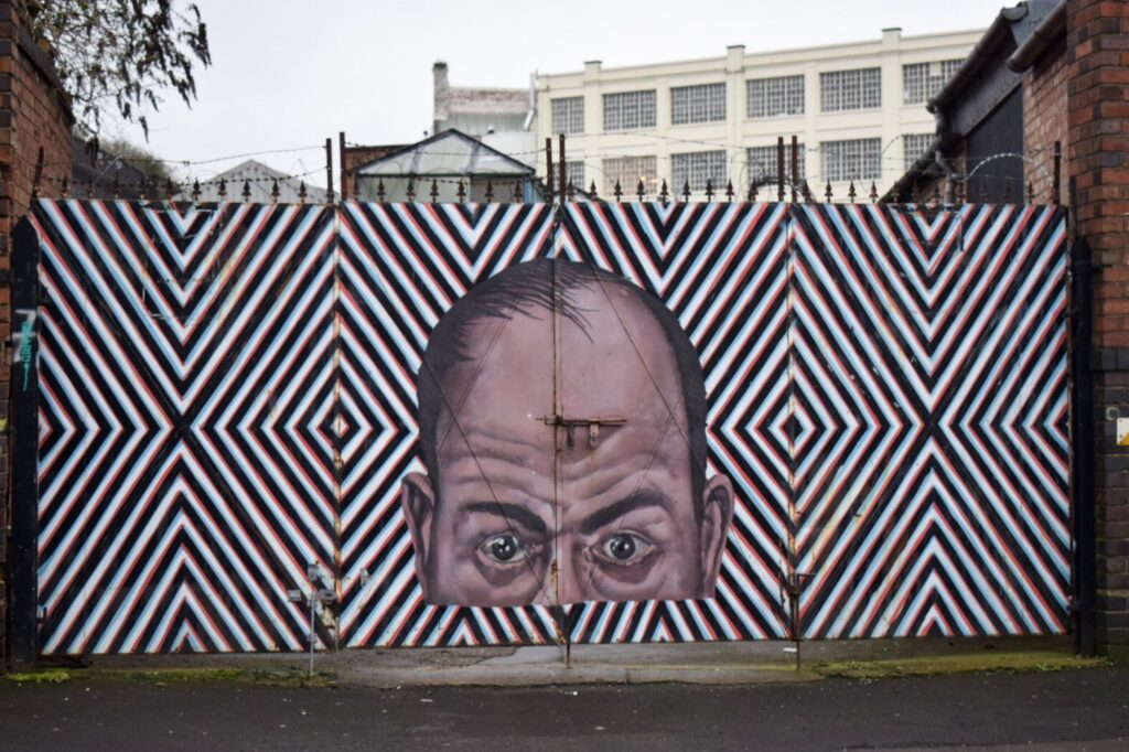 An optical illusion mural featuring portrait of a man's vase by Dan Newso in Digbeth, Birmingham.