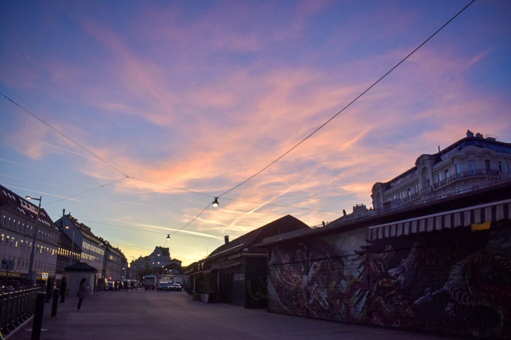 Naschmarkt market and neighbourhood in Vienna at a vivid pink sunset.