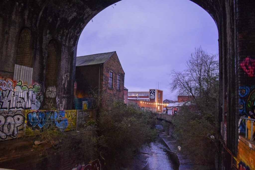 Floodgate Street arches graffiti with a canal running through it.