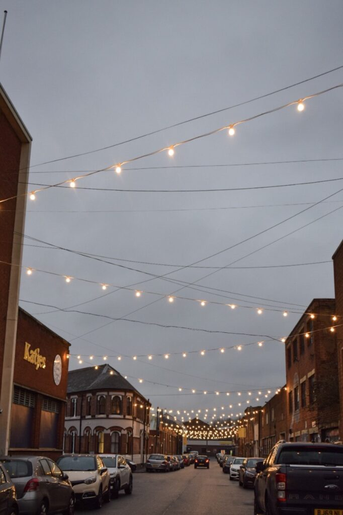 Floodgate Street in Digbeth, Birmingham with strung fairy lights at night.