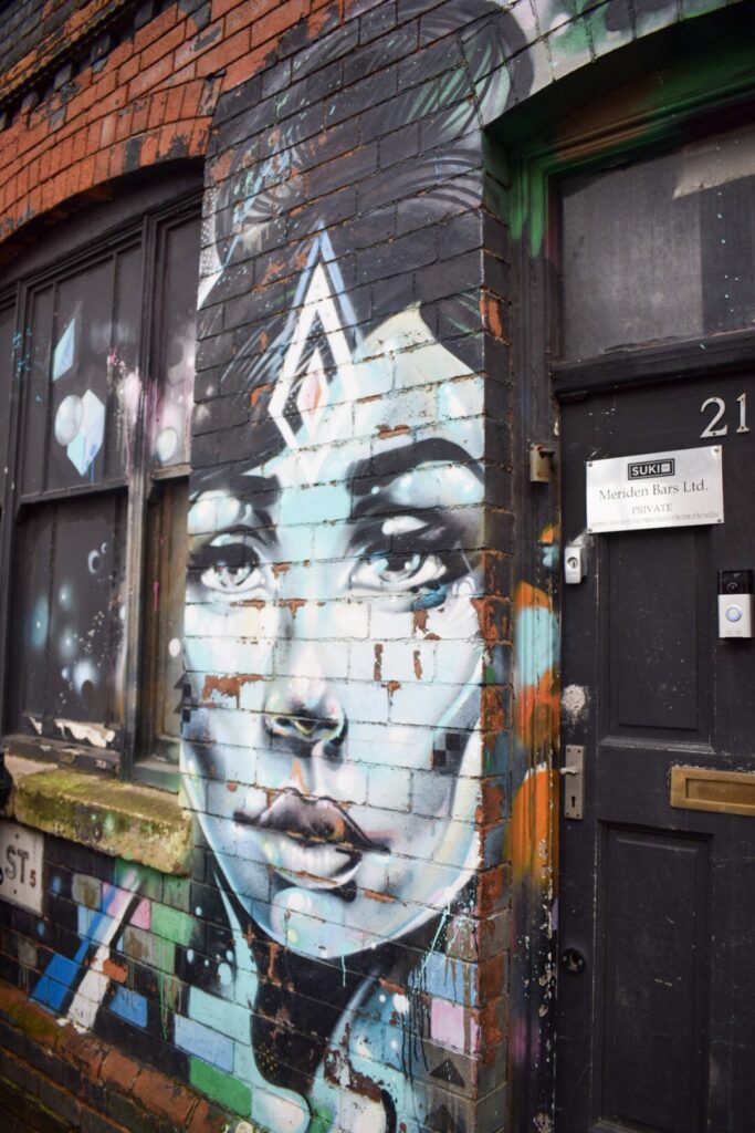 Street art in Digbeth, Birmingham. A mural of a woman's face by Phill Blake.
