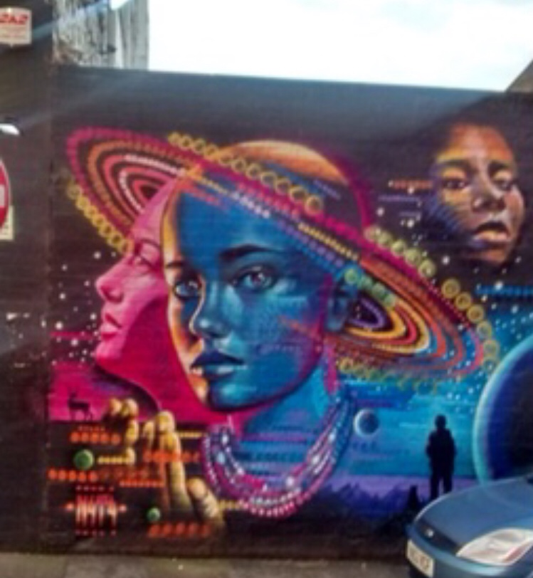 A futuristic space inspired mural in Athens Custard Factory in Birmingham by street artist N4T4.