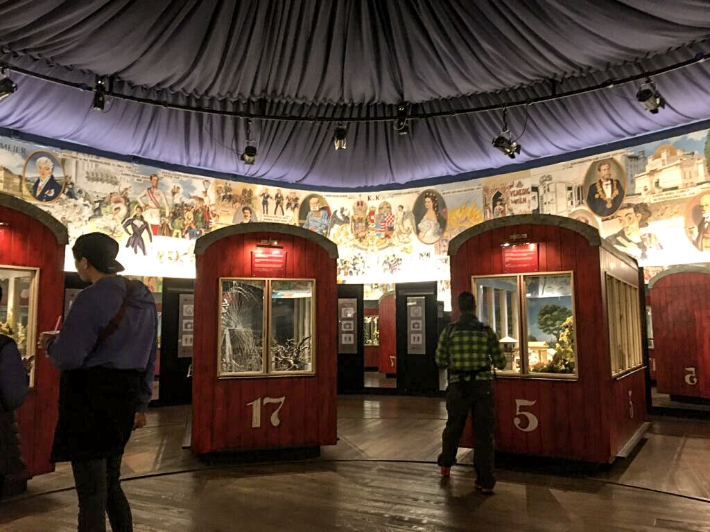 The gondolas in the museum at the base of the giant Ferris wheel in prater fun park, Vienna.