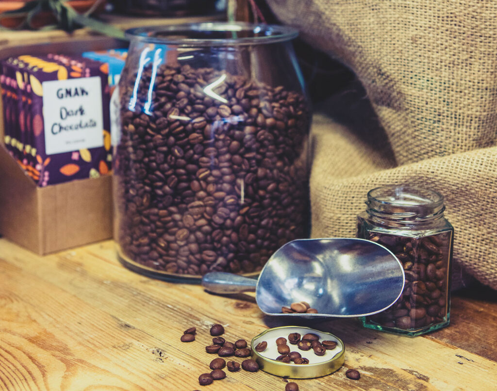 Fresh roasted coffee beans can be poured into a contain this is how it workss