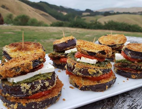 stacked eggplant with roast tomato feta and pesto