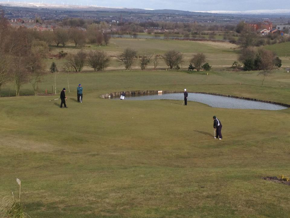 People Playing 18th Hole