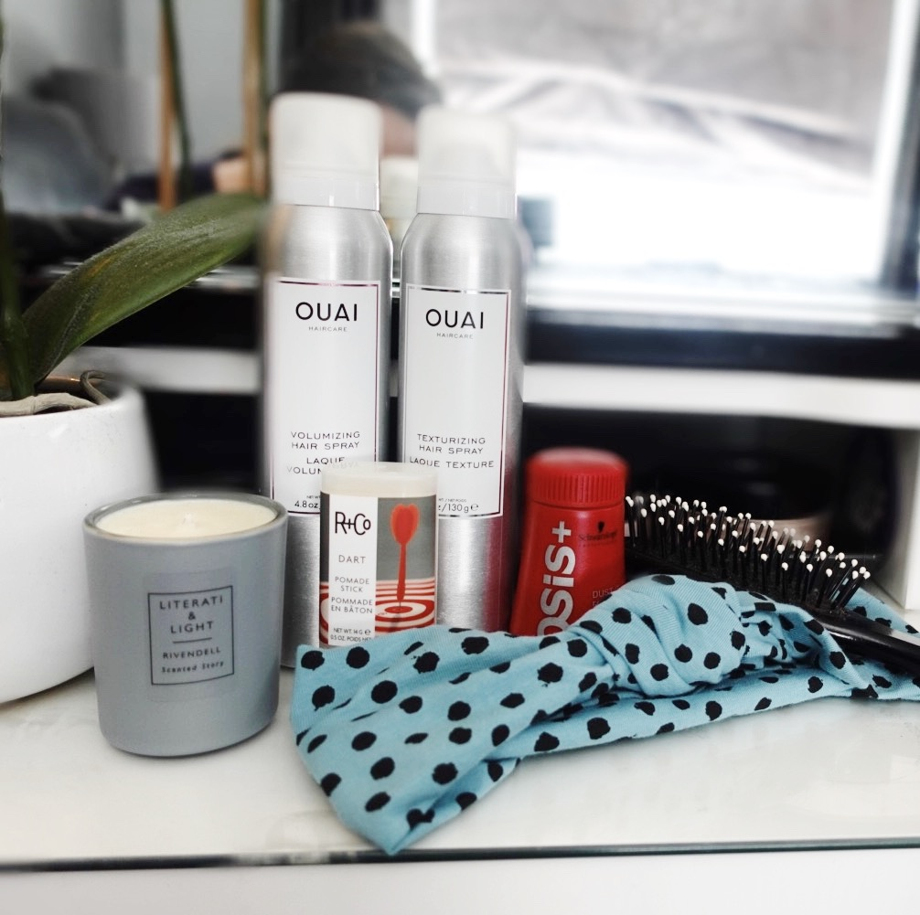 Image contains all the products mentioned in the blog post on top of a white vanity counter.