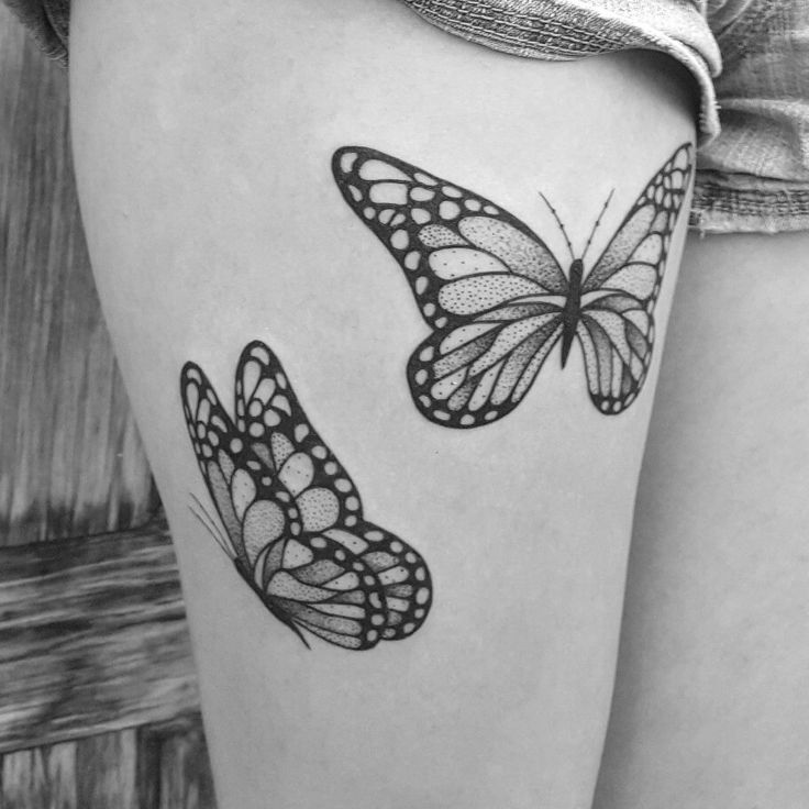 Black And White Butterfly Thigh Tattoo
