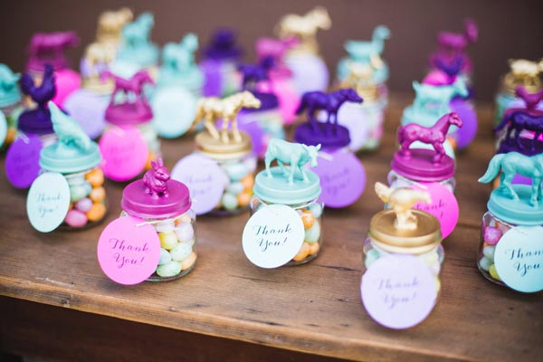 Jars Topped With Bright Blue, Purple And Gold Lids