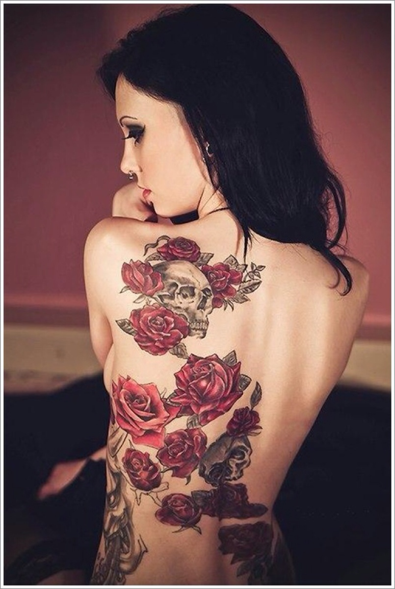 grey skulls and red roses tattoo
