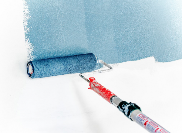 a paint roller is used to apply blue paint