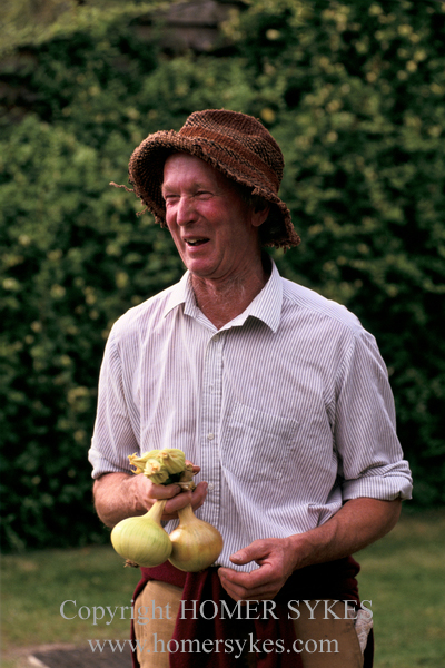 THE MUCH LOVED MARTIN SQUIRES, A LOCAL FARMER WITH HIS BEST ONIONS SELECTED FOR THE EASTLEACH VILLAGE FETE COMPETITION.