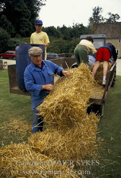 ALL HANDS ON DECK FOR THE PREPARATION OF THE BOWLING ALLEY FOR THE EASTLEACH VILLAGE FETE.