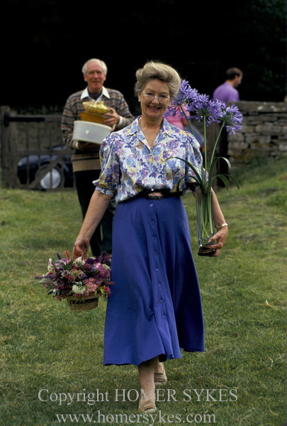 MRS RICHARDS BRINGS TO THE FETE HER ENTRY IN THE FLOWER ARRANGING COMPETITION., AT THE EASTLEACH VILLAGE FETE