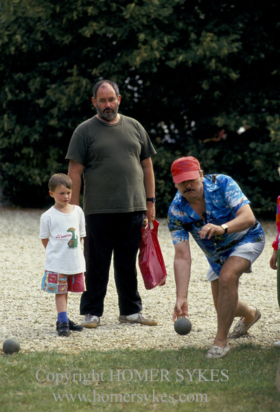 Villagers having fun bowling at the Eastleach village fete