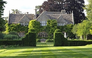 As you pass through the oak door by the house you can see across the croquet lawn to wrought iron gates, decorated with a Clematis motif, which were installed to celebrate the new millennium in 2001.