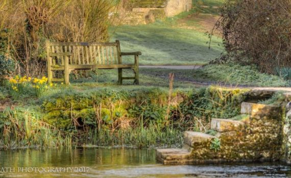 Photo of Mrs Clacks Bench, on the banks of the River Leach, Eastleach, Cotswolds, Gloucestershire, England - Photograph by Any Hill, ATH Photography