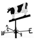 Den's father, Charlie Bartlett, made the cow wind vane found at Hannington Hill Farm, Quenington. It used to stand on the cow shed when it was a dairy farm, but is now in the stable yard.