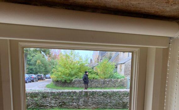 Suspicious Eastern European man checking out houses in Eastleach
