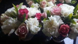 Roses and Carnations in pretty tea cups make a lovely centre piece for your table