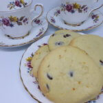 A plate with Chocolate Orange Shortbread and 2 Vintage Tea Cups