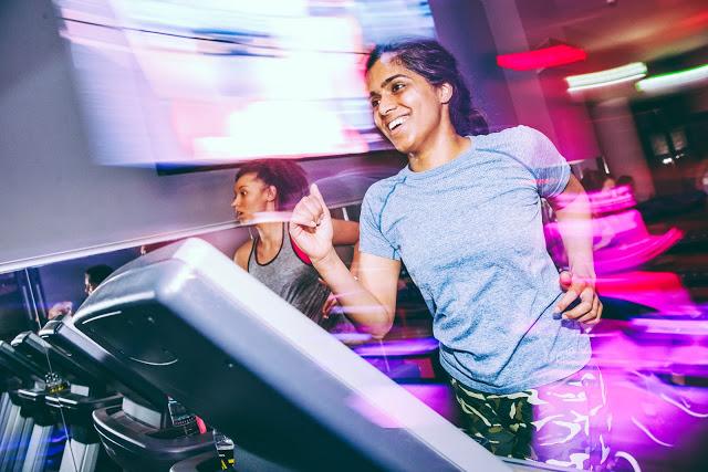 indian woman running on treadmill