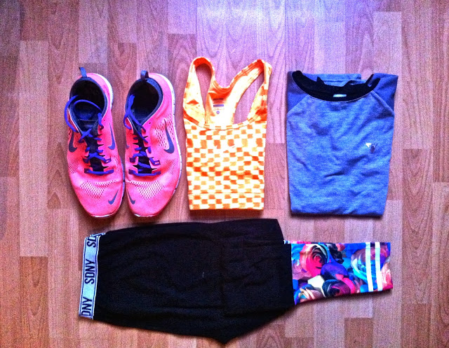 trainers, sports bra, t shirt and leggings folded