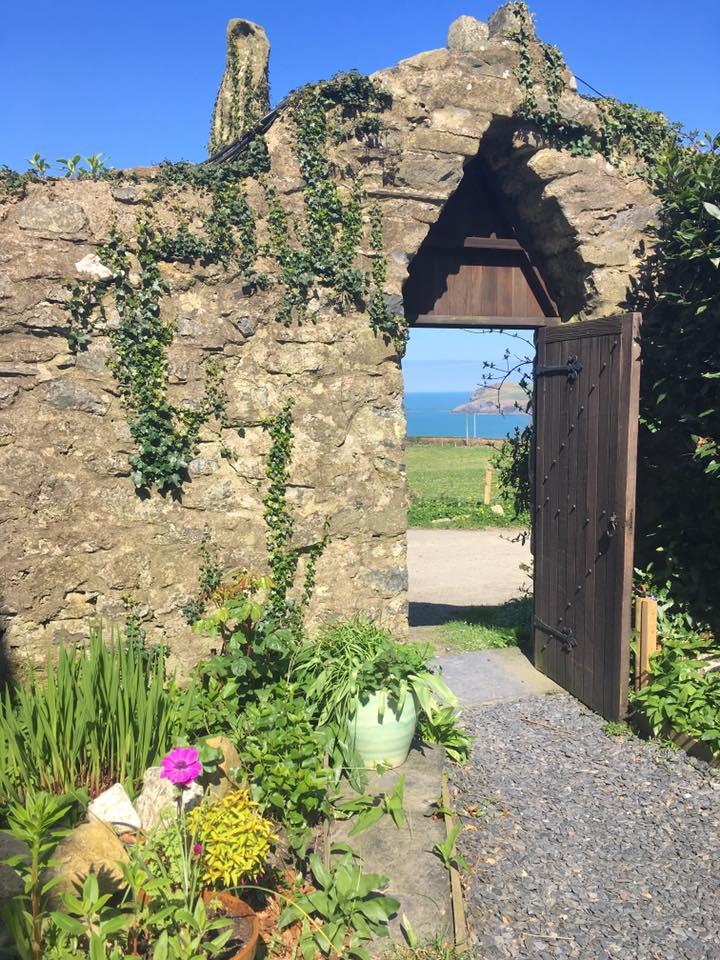 Spring View through Stone Wall