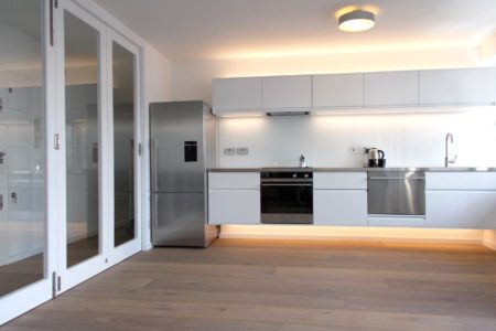 Mayfair flat kitchen and glass partition