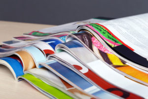 Pile of colourful magazines