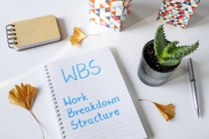 WBS work breakdown structure written in notebook on a white table