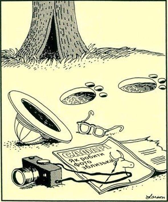 """Смішний малюнок про фотографа.  Лежить фотоапарат, окуляри, головний убір і журнал """"Сафарі. Як робити фото зблизька"""" і сліди хижака"""