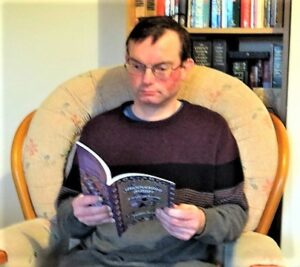 Matthew Ansell with his new book of poetry and artwork Understanding Autism: A Book of Poetry