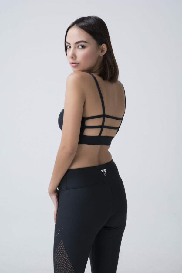 woman in black yoga bra