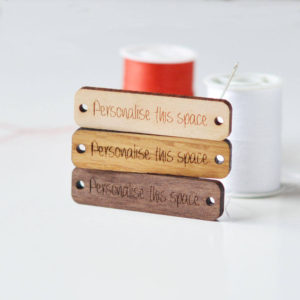 Small rectangular wooden tags