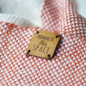 square leather tag