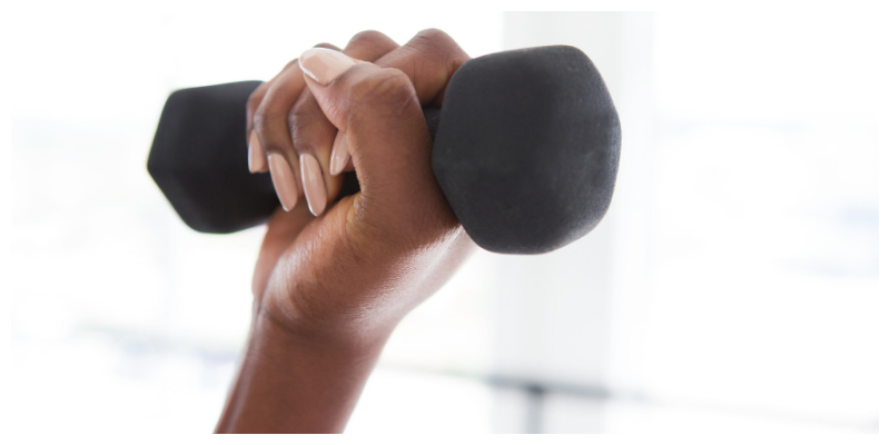 Lifting small dumbells to combat menopausal fatigue