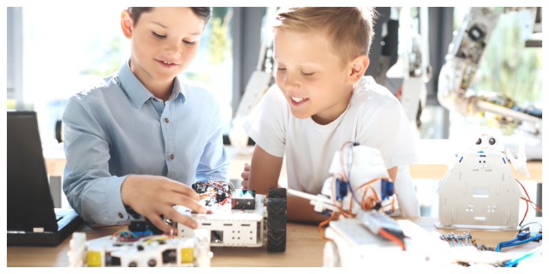 Two boys building a robot . Pros and cons of ADHD medication.