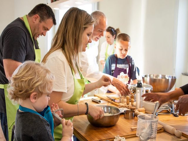 A-lovely-family-making-pasta-and-gelato-at-romecookingworkshop-in-rome