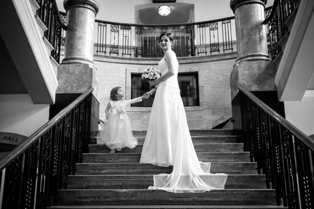 bride and daughter on stairs