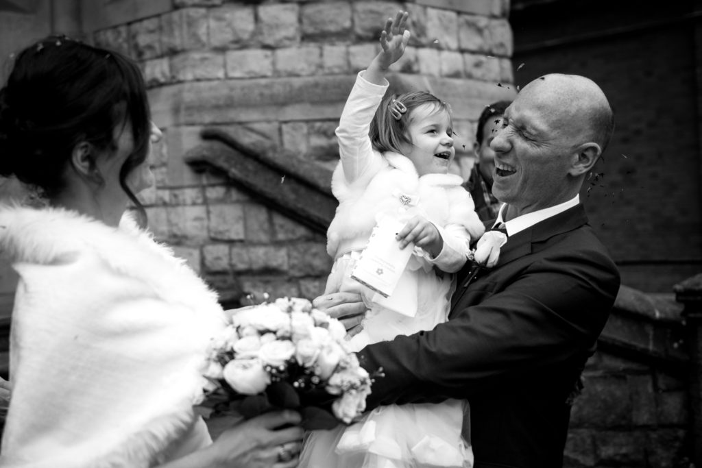 daughter thrown confetti on groom