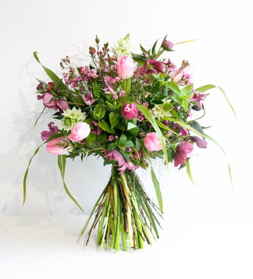 Mixed flower bouquet with tulips and fountain grass, created by Garland