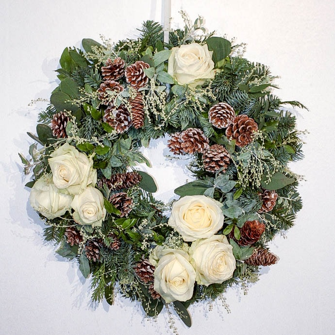 Christmas wreath with white roses