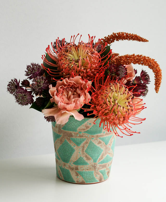 Aqua vase with autumnal flowers