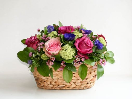 A basket of roses and flowers for Mother's Day, created by North London florist Garland