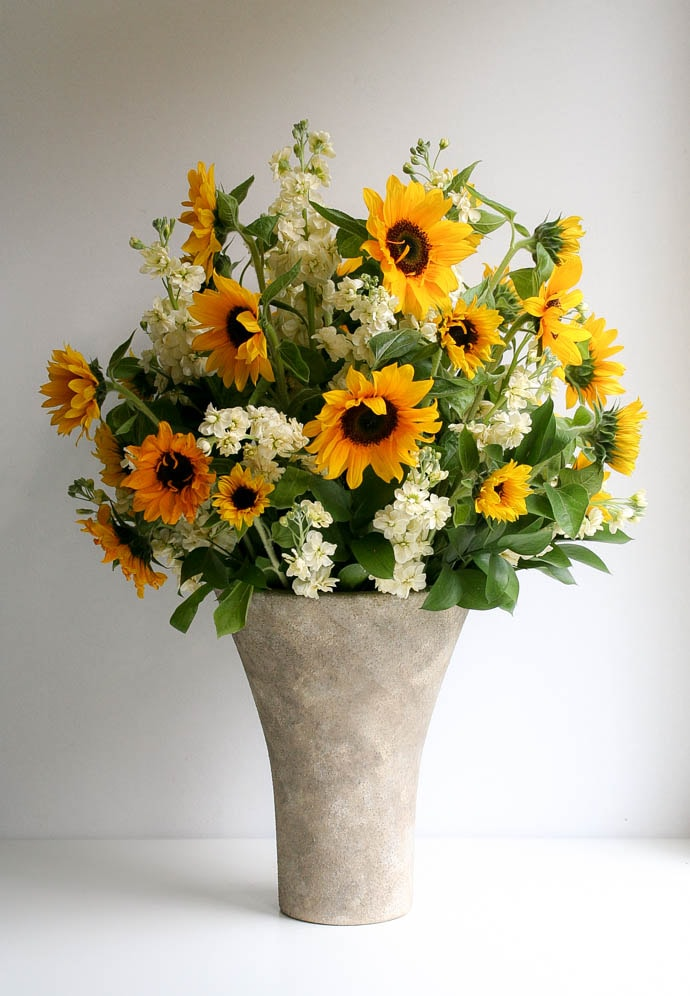 Gorgeous sunflowers with cream stocks, arranged by Garland, north London florist