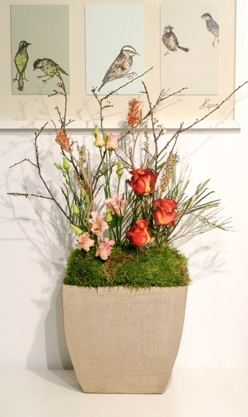 Concrete planter with roses and spring branches