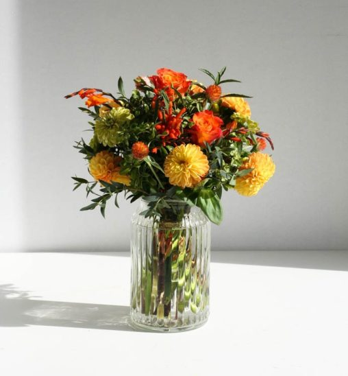 Yellow Dahlia and zinnia, designed by north London florist Garland