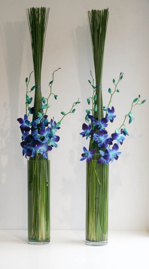 Contract Flowers for office boardroom using bright blue orchids, created by London florist Garland