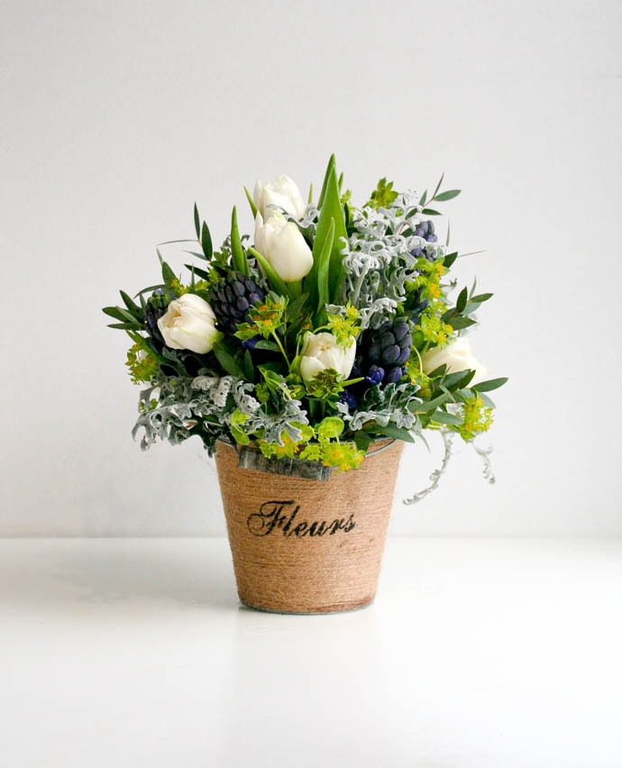 Mother's Day Flowers, seasonal tulips and hyacinth in a zinc detailed bucket. Created by London florist Garland